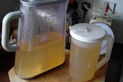 jugs of fresh organic vegetable stock